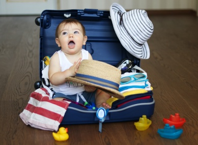 Baby in suitcase ready for travel